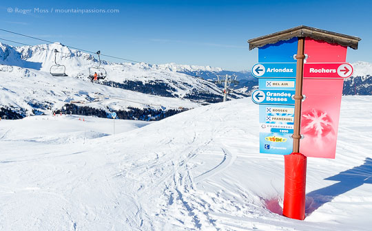 View past ski piste signgage to chair lift at Courchevel Moriond, French Alps.