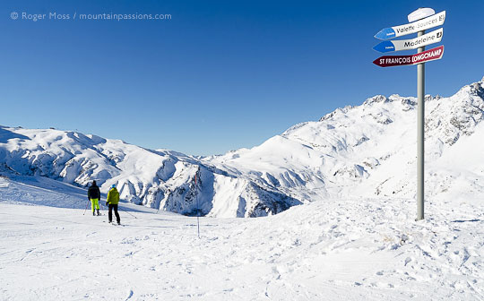 Skiers joining piste above Combe Beaudin, Valmorel, French Alps.