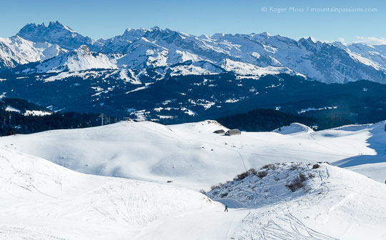 High view of skier on lower section of Lac piste at Praz de Lys Sommand, French Alps.
