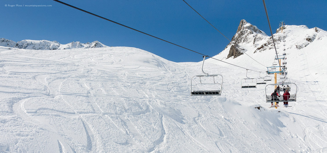 Skier's-eye view of snow-covered mountainside from from chairlift at Luz Ardiden, French Pyrenees.