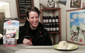 Artisan cheese producer Aurore Delesmillieres in her farm shop, Samoens, French Alps