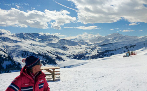 ESF ski instructor and mountain scenery, Areches-Beaufort, French Alps