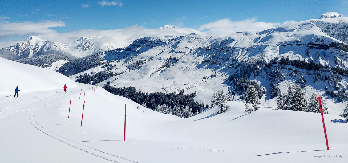 Ski instructor and skier in beautiful mountain setting at Areches-Beaufort, French Alps