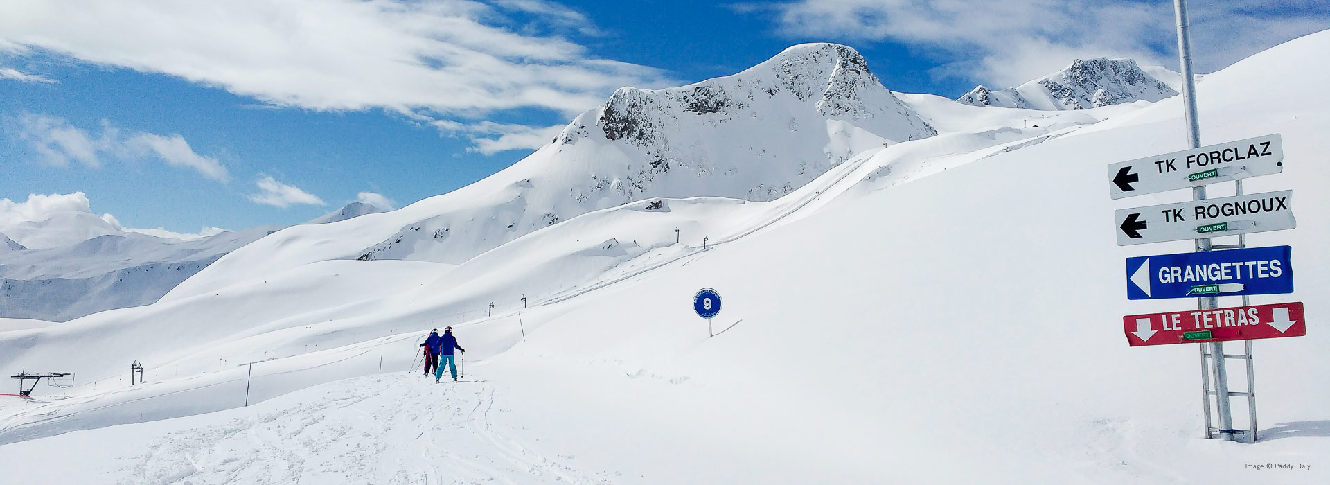 Two skiers on fresh snow in Areches-Beaufort, French Alps