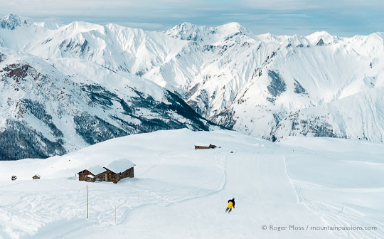 Wide view of lone skier on mountainside