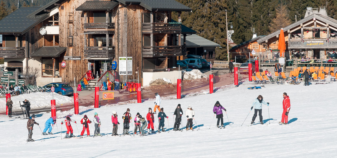 Young skiers ski lesson with ESF monitor, Les Gets, Portes du Soleil