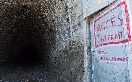 View into interior of unlit stone tunnel du Parpaillon