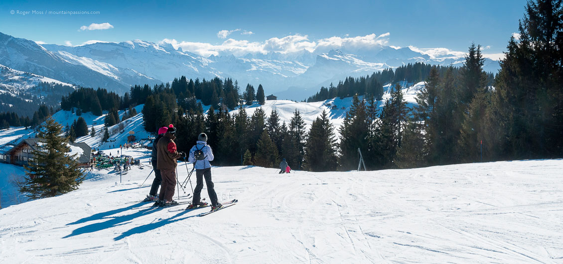 Group of skiers beside piste above Les Gets, French Alps