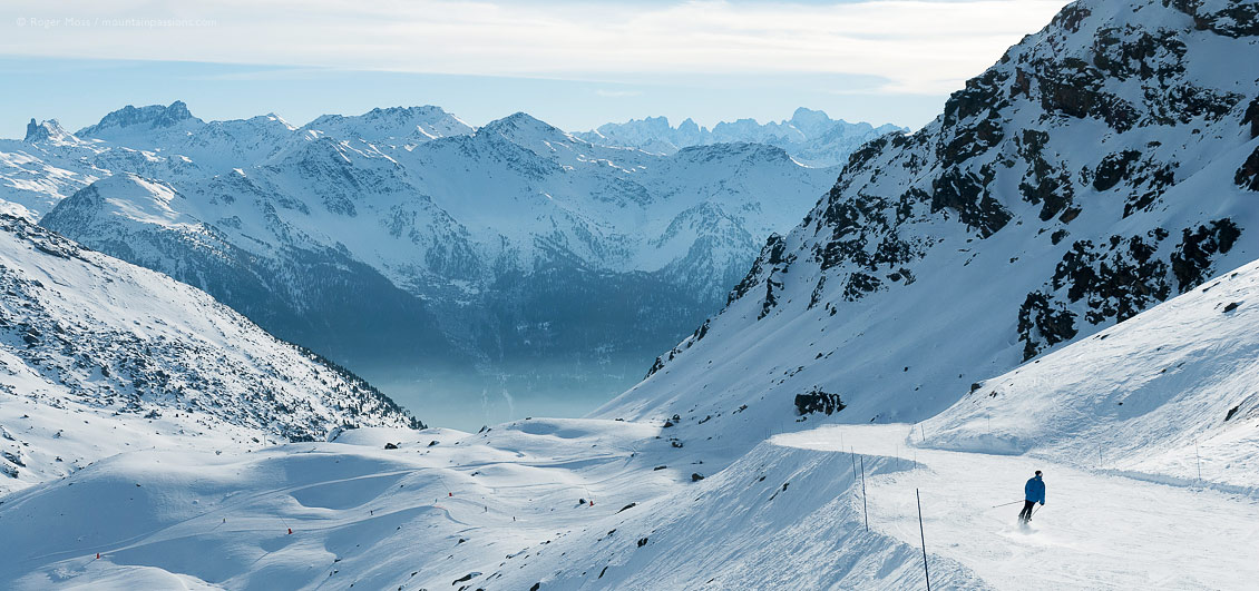Lone skier on piste between Val Thorens and Orelle, French Alps