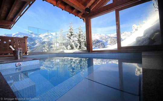 Alpine Infusion's luxury Chalet Genepi pool with a view