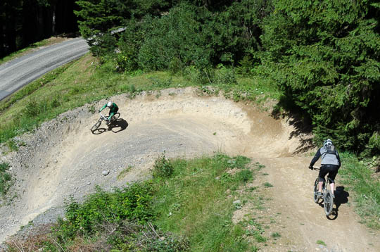 Mountain bikers on forest trail, Châtel
