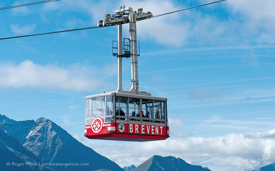 Side view of Brevent cable car with mountains in background above Chamonix
