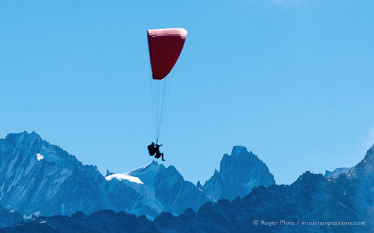 Side view of parapente experience with mountain backdrop above Chamonix