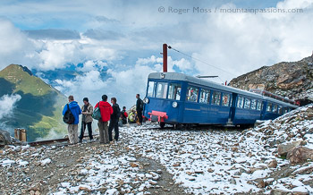 Visitors at high mountain viewpoint beside the Tramway du Mont-Blanc