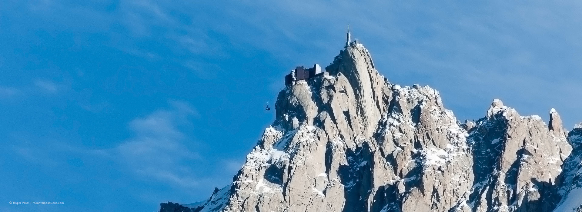 Distant view of Aiguille du Midi cable-car and summit