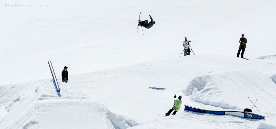 High view of freestyle skier in snowpark on glacier in summer, at Tignes