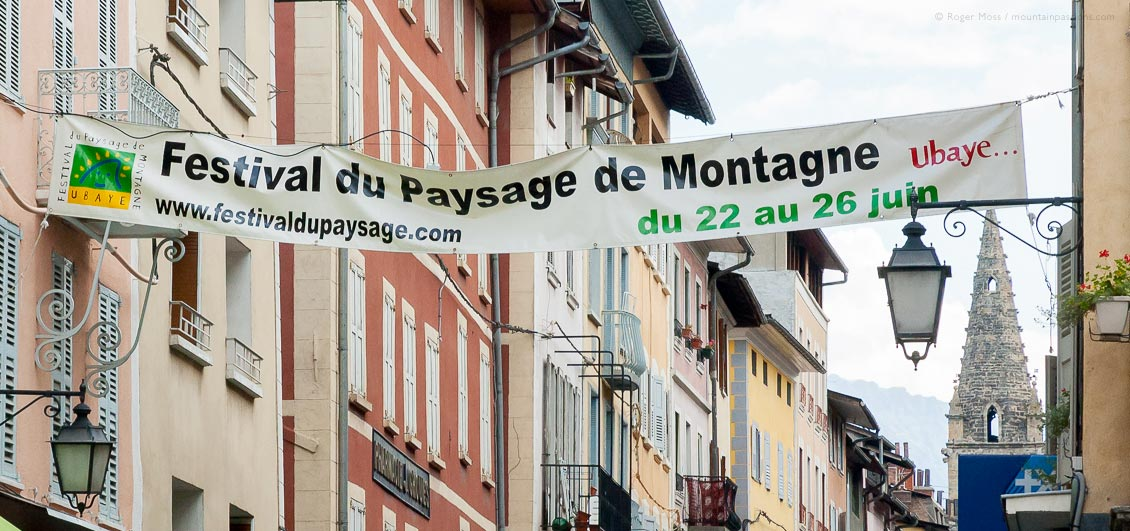View of mountain festival banner across street in Barcelonnette