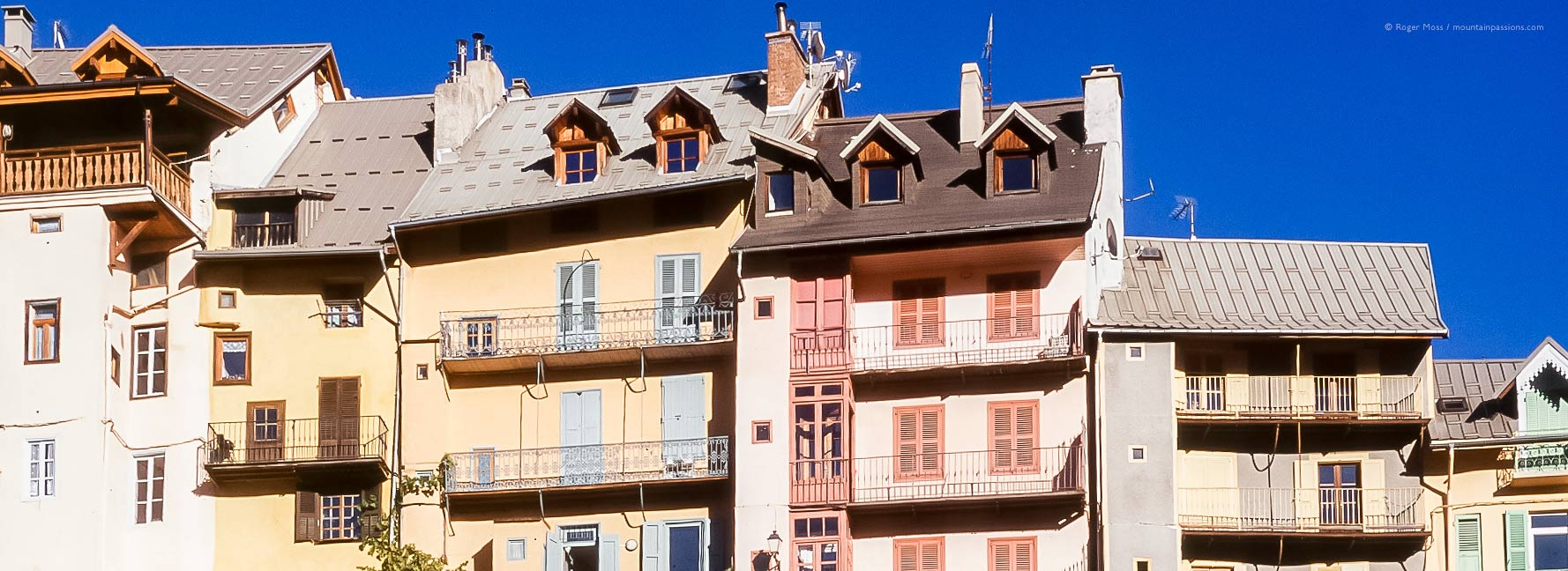 Line of brightly-coloured facades in Briancon, French Alps.