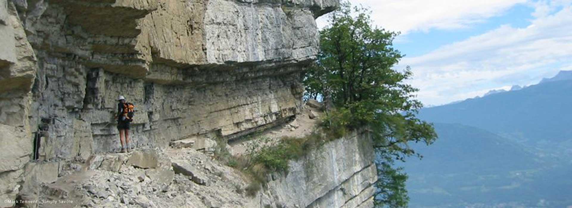 Via ferrata with views below, French Alps