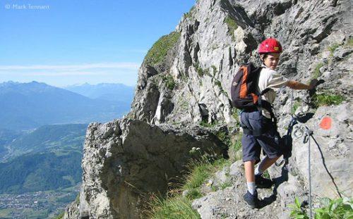 boy on via ferrata route, French Alps
