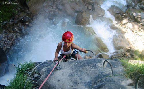 via ferrata above waterfall, French Alps