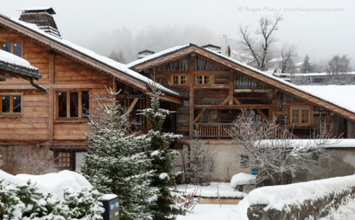 Renovated chalets in winter at Les Carroz, French Alps.