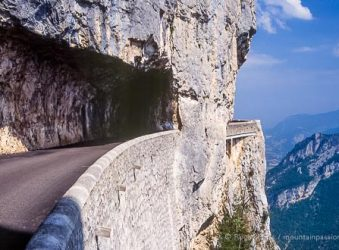 View of high mountain road with tunnel in Vercors