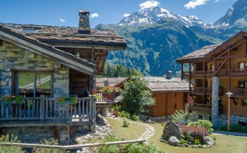 View through village chalets to mountains, Sainte-Foy-Tarentaise