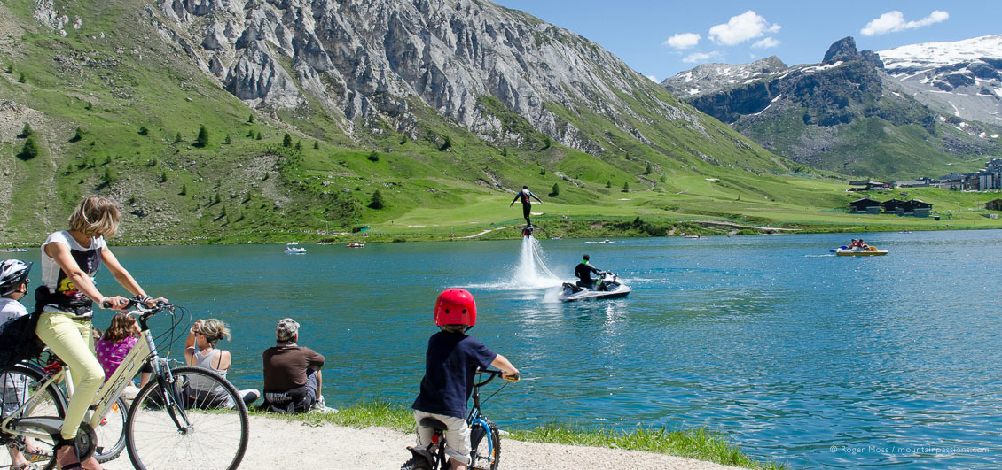 Lakeside view of families watching fly-board demonstration at Tignes