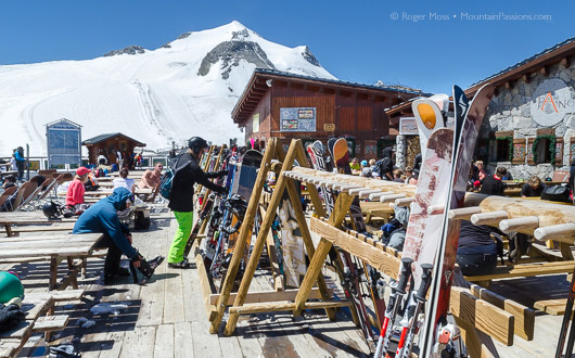 Grande Motte glacier, restaurant terrace with ski racks, view to mountain