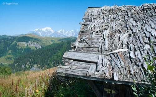 Abandoned mountain chalet with views beyond, Les Saisies