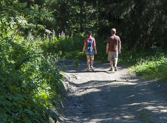 Couple enjoy forest walk at Les Saisies