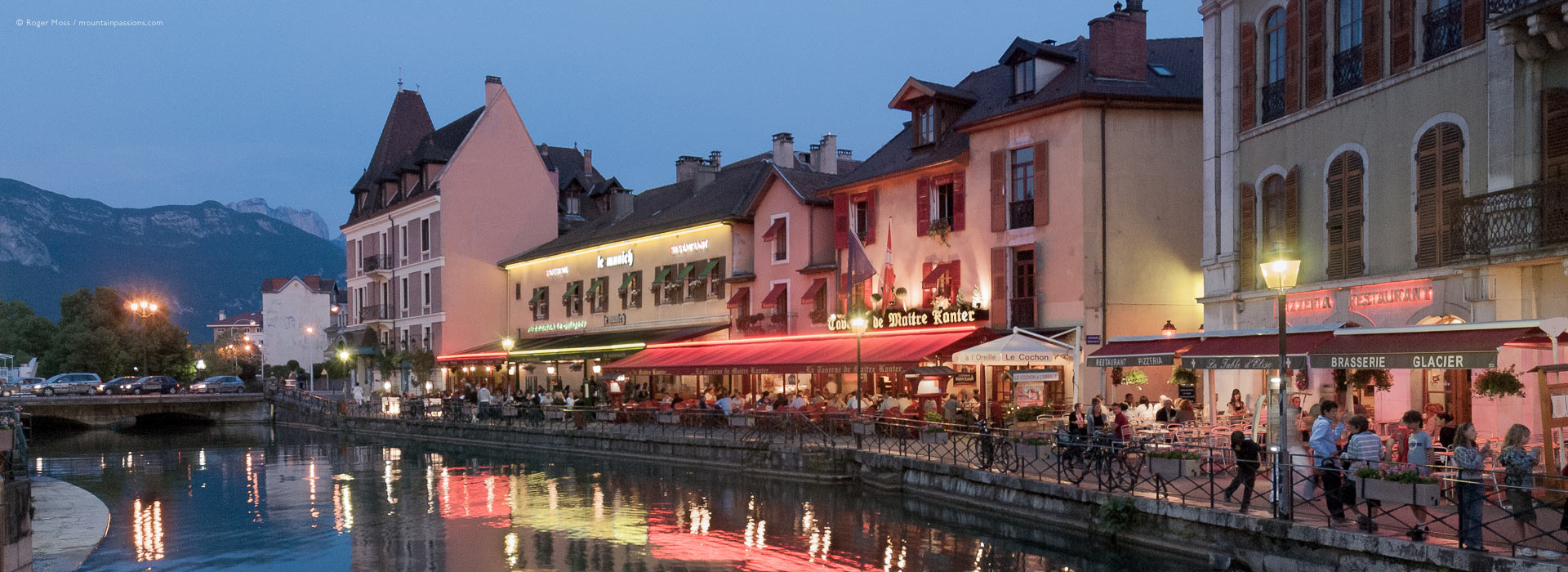 Evening view of quayside bars and restaurants in Annecy
