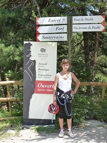 Via Ferrata signage with girl and equipment