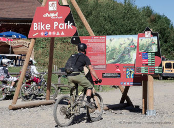 Mountain biker looking at map of Chatel bike park