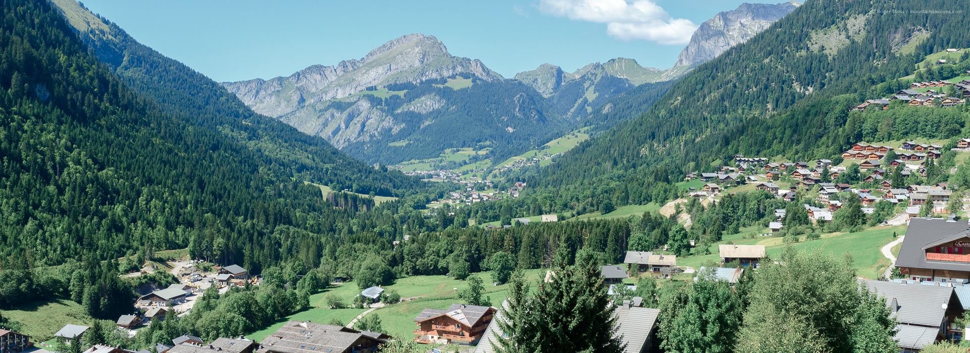 Wide overview of Chatel village and valley with mountains