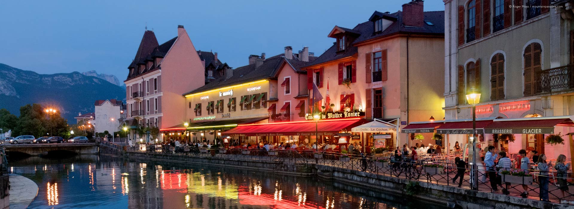 Wide view of quayside restaurants at dusk