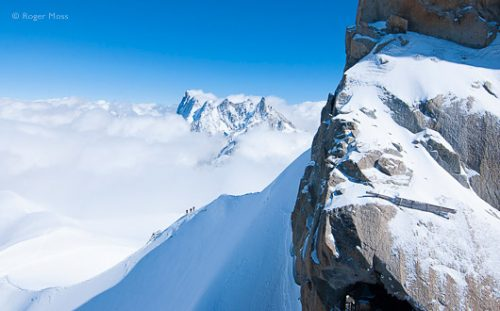 Skiers depart from the Aiguille du Midi, Chamonix, French Alps