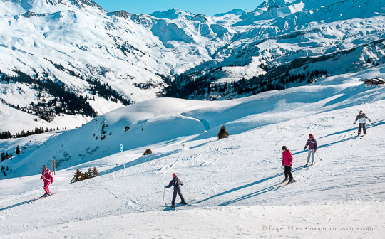ESF ski instructor with young skiers above Areches Beaufort, French Alps.