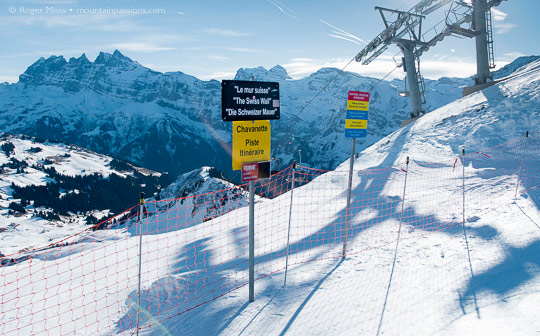 Swiss Wall piste sign, with mountains and ski-lift at Avoriaz, Portes du Soleil, French Alps.