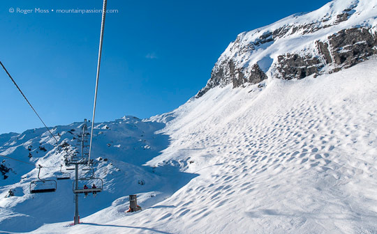 View of ungroomed ski terrain from chairlift above Avoriaz, Portes du Soleil, French Alps.