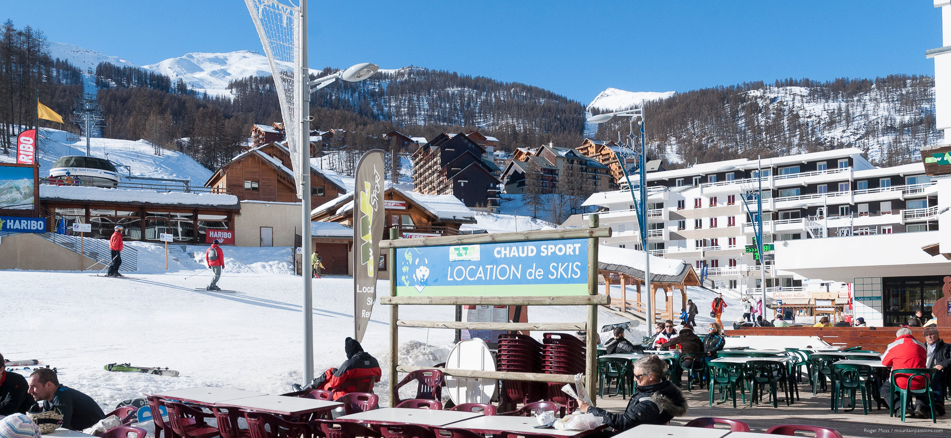 Wide view from cafe terrace, showing village apartments and ski lifts