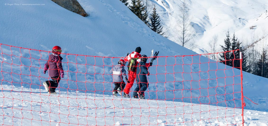 Group of young skiers with ESF ski instructor