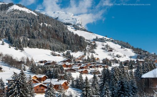 La Clusaz - View across valley to snow-covered mountainside with chalets
