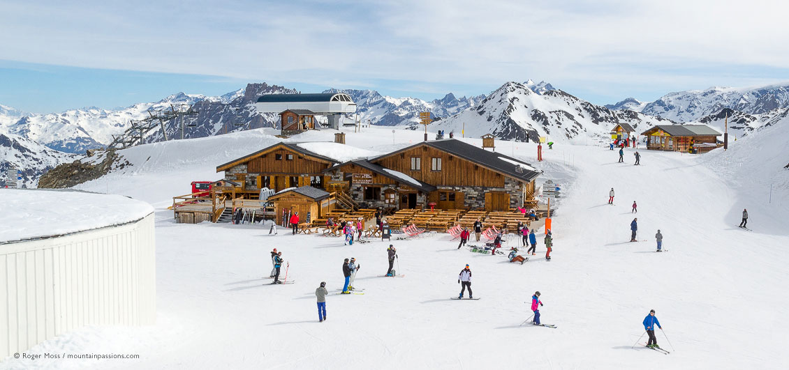 Skiers around mountain restaurant