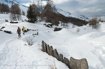 Two walkers in snowy landscape near Sainte Foy Tarentaise, Savoie, French Alps.