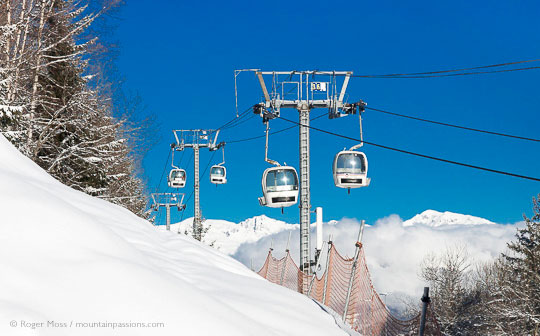 View of gondola ski lift with snow-covered mountainside