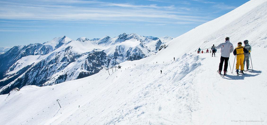 Skiers looking at mountain scenery above Piau Engaly ski resort