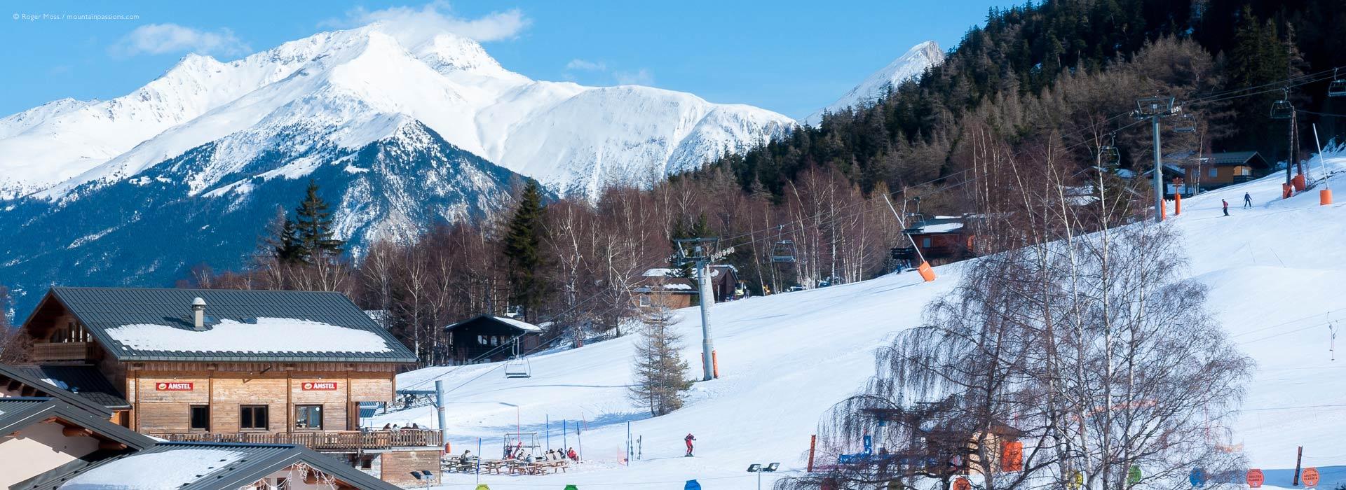 View of ski lifts, bar and mountains at La Norma