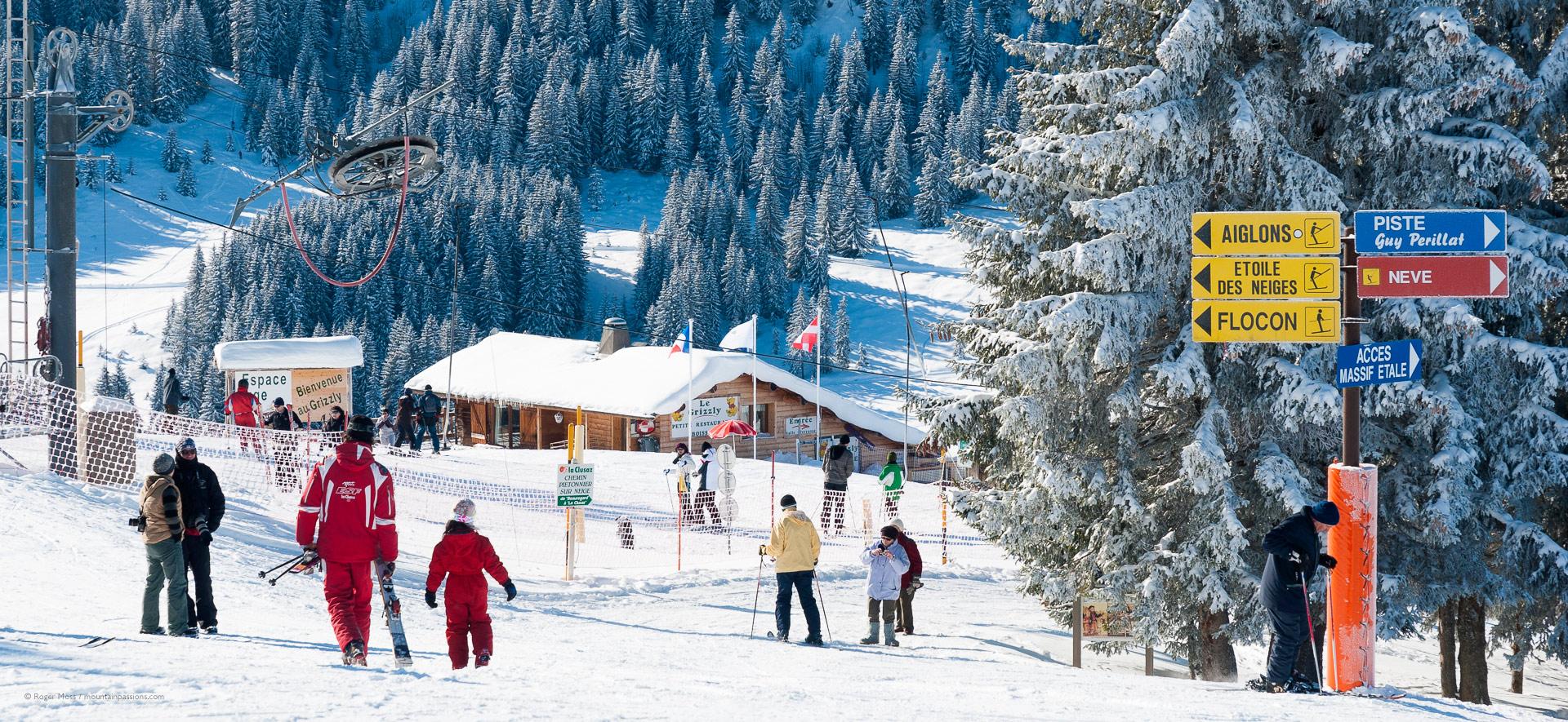 Skiers and ski instructor around debutant area in La Clausaz ski area